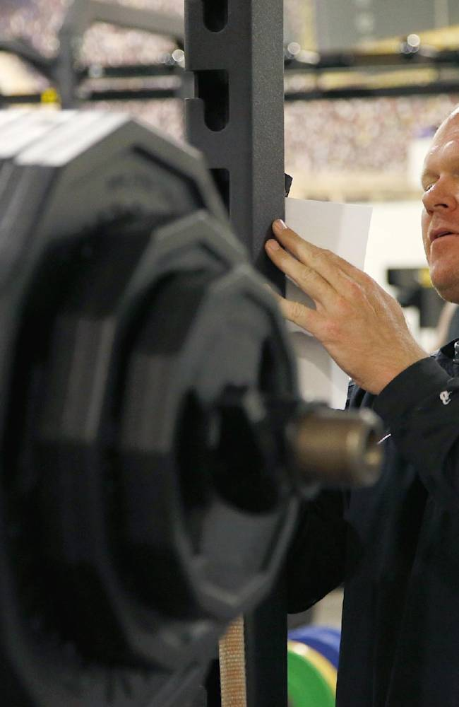 Shawn Griswold, Arizona State's head coach of sports performance for football, writes down notes at the football weight training room on Monday, July 21, 2014, in Tempe, Ariz