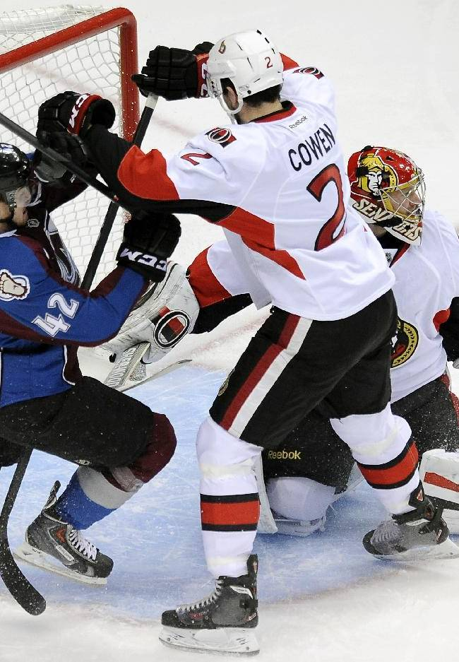 Colorado Avalanche center Brad Malone, left, and Ottawa Senators defenseman Jared Cowen, center, fight for position in front of Ottawa Senators goalie Craig Anderson, right, in the first period of an NHL hockey game on Wednesday, Jan. 8, 2014, in Denver