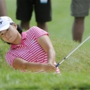 Yani Tseng, of Taiwan, hits out of a trap during the Wegmans LPGA golf championship in Pittsford, N.Y., Sunday, Aug. 17, 2014. (AP Photo/Gary Wiepert)