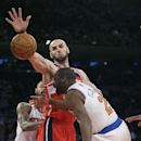 Washington Wizards' Marcin Gortat, left, blocks a shot by New York Knicks' Raymond Felton during the first half of an NBA basketball game Friday, April 4, 2014, in New York The Associated Press