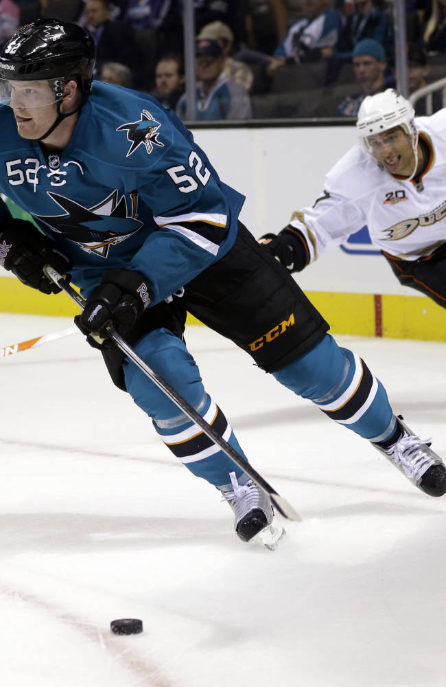 San Jose Sharks defenseman Matt Irwin, left, is chased by Anaheim Ducks center Andrew Cogliano during the second period of a preseason NHL hockey game on Friday, Sept. 20, 2013, in San Jose, Calif