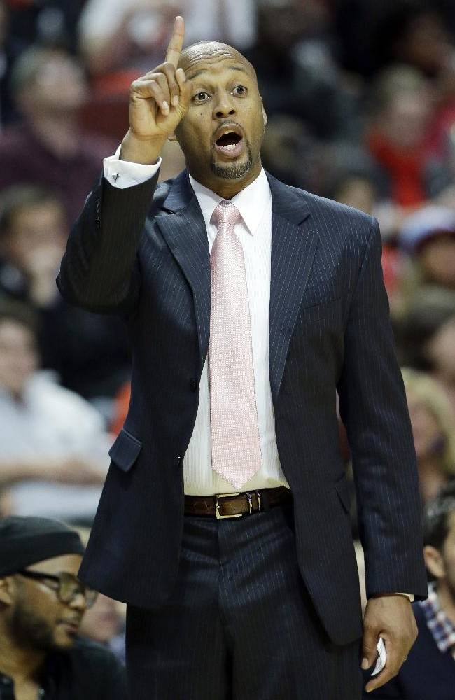 Denver Nuggets head coach Brian Shaw points as he talks to his team during the second half of an NBA preseason basketball game against the Chicago Bulls in Chicago on Friday, Oct. 25, 2013. The Bulls won 94-89