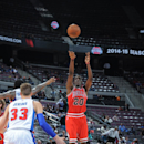 AUBURN HILLS, MI - OCTOBER 7: Tony Snell #20 of the Chicago Bulls shoots against the Detroit Pistons during the game on October 7, 2014 at The Palace of Auburn Hills in Auburn Hills, Michigan. (Photo by Allen Einstein/NBAE via Getty Images)