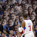 In this Jan. 9, 2013, file photo, Los Angeles Clippers guard Chris Paul looks on as fans hold up pictures of him during the first half of their NBA basketball game against the Dallas Mavericks in Los Angeles. The photo was part of a series of images by ph