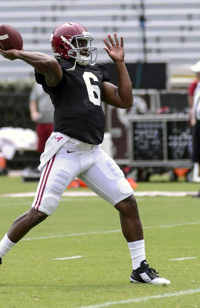 Alabama quarterback Blake Sims (6) works through drills before the scrimmage at football practice, Saturday, Aug. 9, 2014, at Bryant-Denny Stadium in Tuscaloosa, Ala