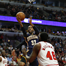 Indiana Pacers guard C.J. Watson (32) goes to the basket against Chicago Bulls center Nazr Mohammed (48) during the second quarter of an NBA basketball game in Chicago, Saturday, Nov. 16, 2013 The Associated Press
