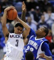 Connecticut's Jeremy Lamb, left, grabs a rebound from Seton Hall's Fuquan Edwin during the first half of an NCAA college basketball game in Hartford, Conn., on Saturday, Feb. 4, 2012. (AP Photo/Fred Beckham)