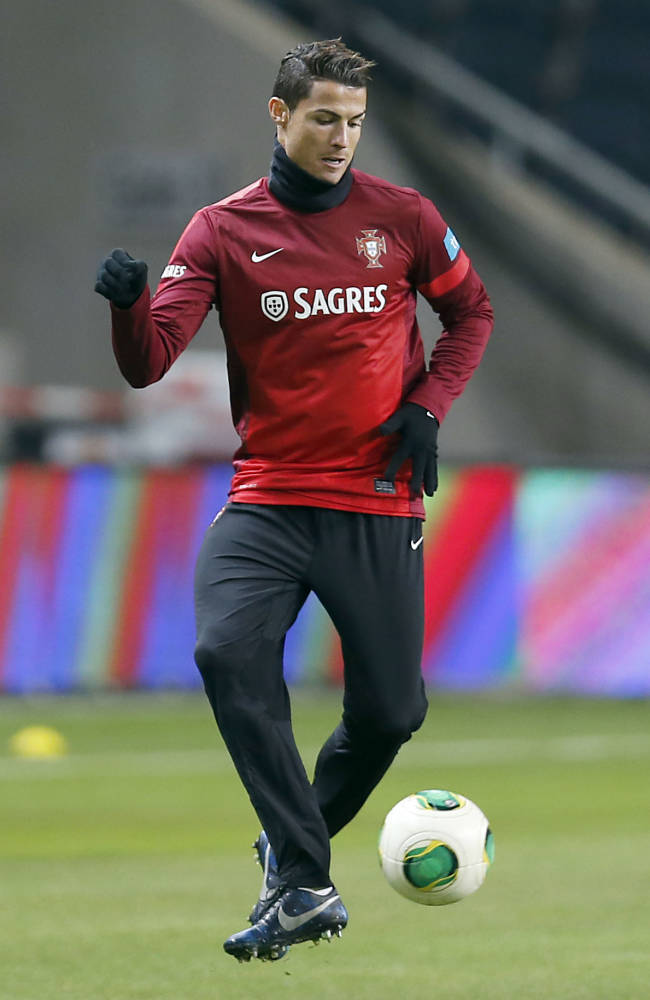 Portugal's Cristiano Ronaldo kicks a ball during a training session a day ahead of the World Cup qualifying playoff second leg soccer match between Sweden and Portugal in Stockholm, Sweden, Monday, Nov. 18, 2013