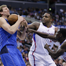 Dallas Mavericks' Dirk Nowitzki, left, gets a rebound against Los Angeles Clippers' Darren Collison, right, and Glen Davis during the first half of an NBA basketball game on Thursday, April 3, 2014, in Los Angeles The Associated Press