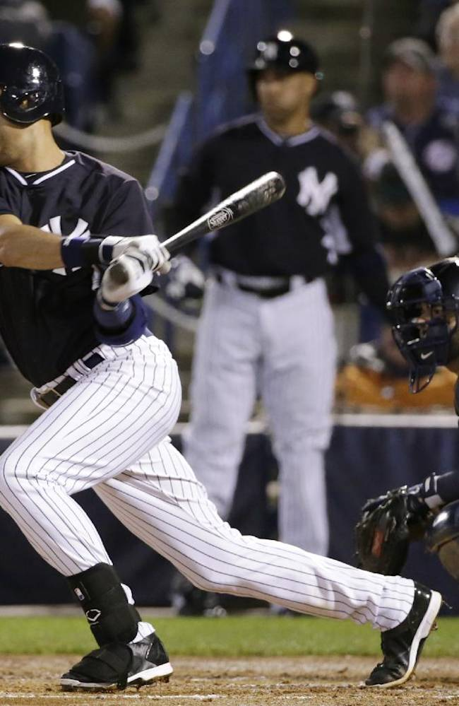 New York Yankees' Derek Jeter hits a third-inning single during a spring training baseball game against the Detroit Tigers in Tampa, Fla., Friday, March 7, 2014