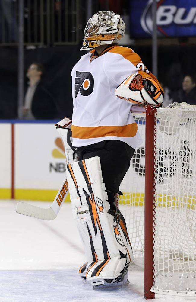 Philadelphia Flyers goalie Ray Emery reacts after being scored on by New York Rangers' Chris Kreider during the second period of the NHL hockey game, Sunday, Jan. 12, 2014, in New York