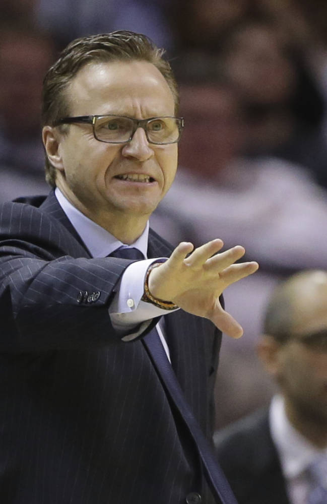 Oklahoma City Thunder coach Scott Brooks talks to his players during the second half of an NBA basketball game against the San Antonio Spurs, Wednesday, Jan. 22, 2014, in San Antonio. Oklahoma City won 111-105