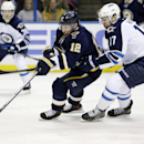 St. Louis Blues' Derek Roy, left, and Winnipeg Jets' James Wright chase after a loose puck during the second period of an NHL hockey game Saturday, Feb. 8, 2014, in St. Louis The Associated Press