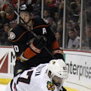 Anaheim Ducks right wing Corey Perry (10) passes the puck around Chicago Blackhawks defenseman Johnny Oduya (27), of Sweden, during the second period of an NHL hockey game in Anaheim, Calif., Friday, Jan. 30, 2015 The Associated Press
