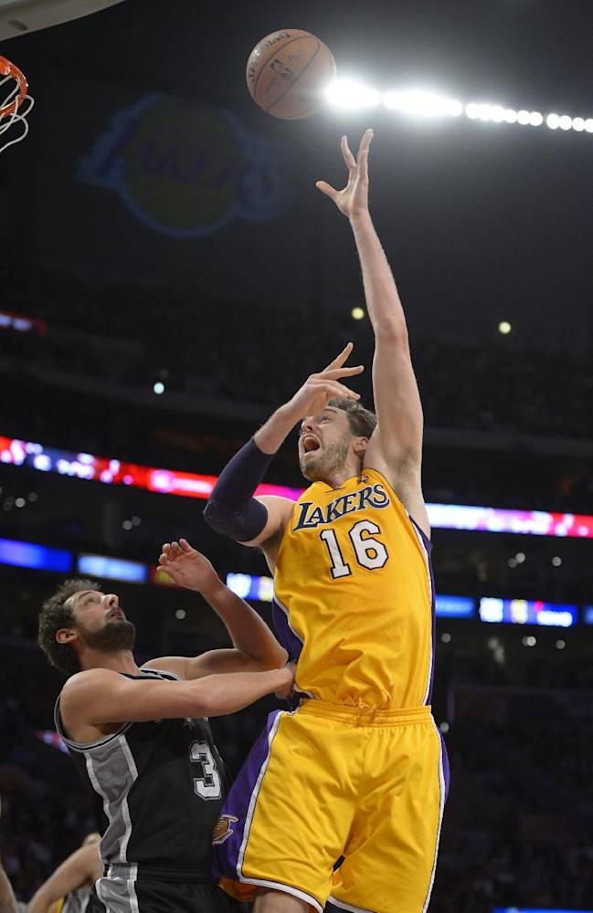 Los Angeles Lakers center Pau Gasol, right, of Spain, puts up a shot as San Antonio Spurs guard Marco Belinelli, of Italy, defends during the second half of their NBA basketball game, Wednesday, March 19, 2014, in Los Angeles. The Spurs won 125-109