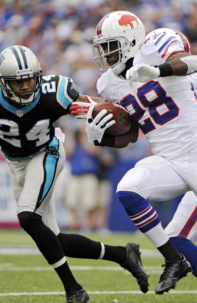 Buffalo Bills running back C.J. Spiller (28) runs the ball against Carolina Panthers cornerback Josh Norman (24) in the second quarter of an NFL football game Sunday, Sept. 15, 2013, in Orchard Park, N.Y