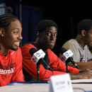 San Diego State forward Josh Davis, left, answers questions as forward Dwayne Polee II, center, and guard Xavier Thames listen during a news conference at the NCAA men's college basketball tournament, Wednesday, March 26, 2014, in Anaheim, Calif. San Dieg