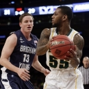 Brigham Young's Brock Zylstra (13) defends Baylor's Pierre Jackson (55) during the first half of an NIT semifinal basketball game Tuesday, April 2, 2013, in New York. (AP Photo/Frank Franklin)