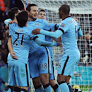 Manchester City's Frank Lampard, middle, celebrates with team mates after scoring against Leicester during the English Premier League soccer match between Leicester City and Manchester City at King Power Stadium, in Leicester, England, Saturday, Dec. 13,