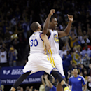 Golden State Warriors' Harrison Barnes (40) celebrates his three-point basket with teammate Stephen Curry (30) during the second half of an NBA basketball game on Tuesday, Dec. 3, 2013, in Oakland, Calif. Golden State won 112-103 The Associated Press