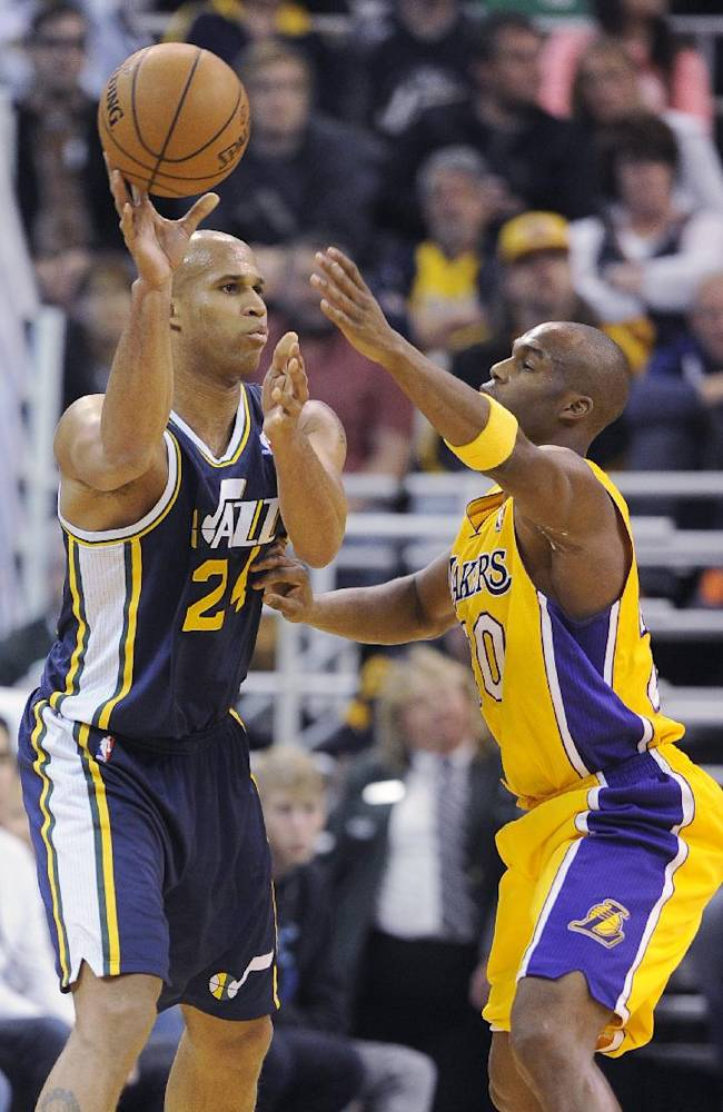 Utah Jazz's Richard Jefferson, left, passes around Los Angeles Lakers' Jodie Meeks during the first half of an NBA basketball game Friday, Dec. 27, 2013, in Salt Lake City