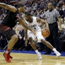 Villanova's Achraf Yacoubou, right, dribbles against Louisville's Chane Behanan during the second half of an NCAA college basketball game, Tuesday, Jan. 22, 2013, in Philadelphia. Villanova won 73-64. (AP Photo/Matt Slocum)
