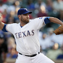 Colby Lewis gets 11th win as Rangers beat Yankees 5-2 The Associated Press