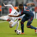 Bayern's Jerome Boateng, right, and Manchester City's Edin Dzeko challenge for the ball during the Champions League group D soccer match between FC Bayern Munich and Manchester City, in Munich, southern Germany, Tuesday, Dec. 10, 2013