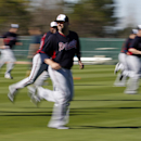 Atlanta Braves relief pitcher Jordan Walden, center, runs during a spring training baseball workout, Sunday, Feb. 16, 2014, in Kissimmee, Fla The Associated Press