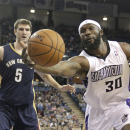 Sacramento Kings forward Reggie Evans, right, reaches for a rebound against New Orleans Pelicans center Jeff Withey (5) during the third quarter of an NBA basketball game in Sacramento, Calif., Monday, March 3, 2014. The Kings won 96-89 The Associated Pr