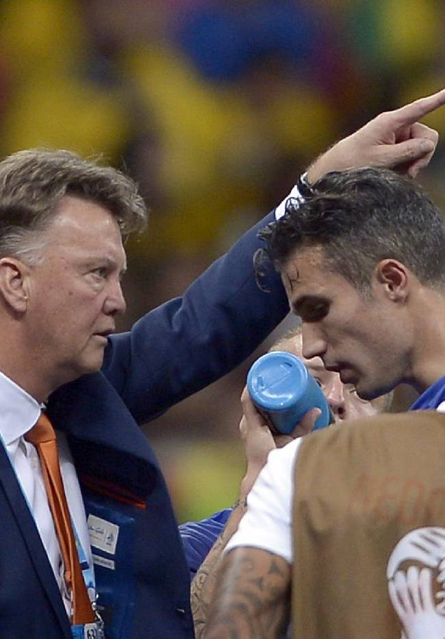 Netherlands' head coach Louis van Gaal gestures to Robin van Persie during the World Cup third-place soccer match between Brazil and the Netherlands at the Estadio Nacional in Brasilia, Brazil, Saturday, July 12, 2014