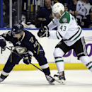 St. Louis Blues' Vladimir Sobotka, left, of the Czech Republic, and Dallas Stars' Valeri Nichushkin, of Russia, keep their eyes on the puck during the first period of an NHL hockey game Saturday, March 29, 2014, in St. Louis The Associated Press