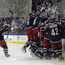 Columbus Blue Jackets celebrate their win over the Pittsburgh Penguins in Game 4 of a first-round NHL playoff hockey series Wednesday, April 23, 2014, in Columbus, Ohio. The Blue Jackets defeated the Penguins 4-3 in overtime. (AP Photo/Jay LaPrete)