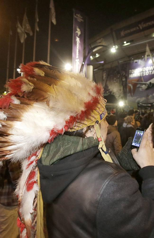American Indians and their supporters gather outside the Metrodome during a protest against the Washington Redskins' name, before an NFL football game between the Redskins and the Minnesota Vikings, Thursday, Nov. 7, 2013, in Minneapolis