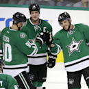 Dallas Stars' Ales Hemsky (83) of Czech Republic, Jason Spezza (90) and Jamie Benn (14) congratulate Tyler Seguin (91) on his goal in the third period of a preseason NHL hockey game against the Florida Panthers, Monday, Sept. 29, 2014, in Dallas. Seguin s