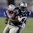 New England Patriots cornerback Darrelle Revis, left, tries to wrap up Carolina Panthers wide receiver Kelvin Benjamin (13) in the first half of an NFL preseason football game Friday, Aug. 22, 2014, in Foxborough, Mass The Associated Press