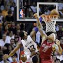 Sacramento Kings' Derrick Williams (13) shoots as he is fouled by Miami Heat's Ray Allen (34) in the first half of an NBA basketball game, Friday, Dec. 20, 2013, in Miami. At right is Miami Heat's Chris Andersen (11). (AP Photo/Lynne Sladky)