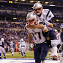 New England Patriots quarterback Tom Brady, top, jumps on the back of tight end Rob Gronkowski after Gronkowski scored a touchdown against the Indianapolis Colts during the second half of an NFL football game in Indianapolis, Sunday, Nov. 16, 2014 The Ass
