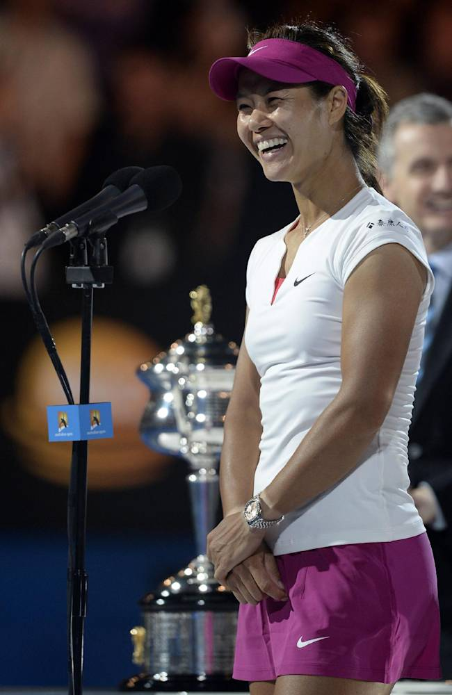 Li Na of China speaks after defeating Dominika Cibulkova of Slovakia during the awarding ceremony  after their women's singles final at the Australian Open tennis championship in Melbourne, Australia, Saturday, Jan. 25, 2014