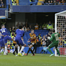 Chelsea's Gary Cahill, third left, scores a goal during the English FA Cup 4th round soccer match between Bradford City and Chelsea at Stamford Bridge, London, England, Saturday, Jan. 24, 2015