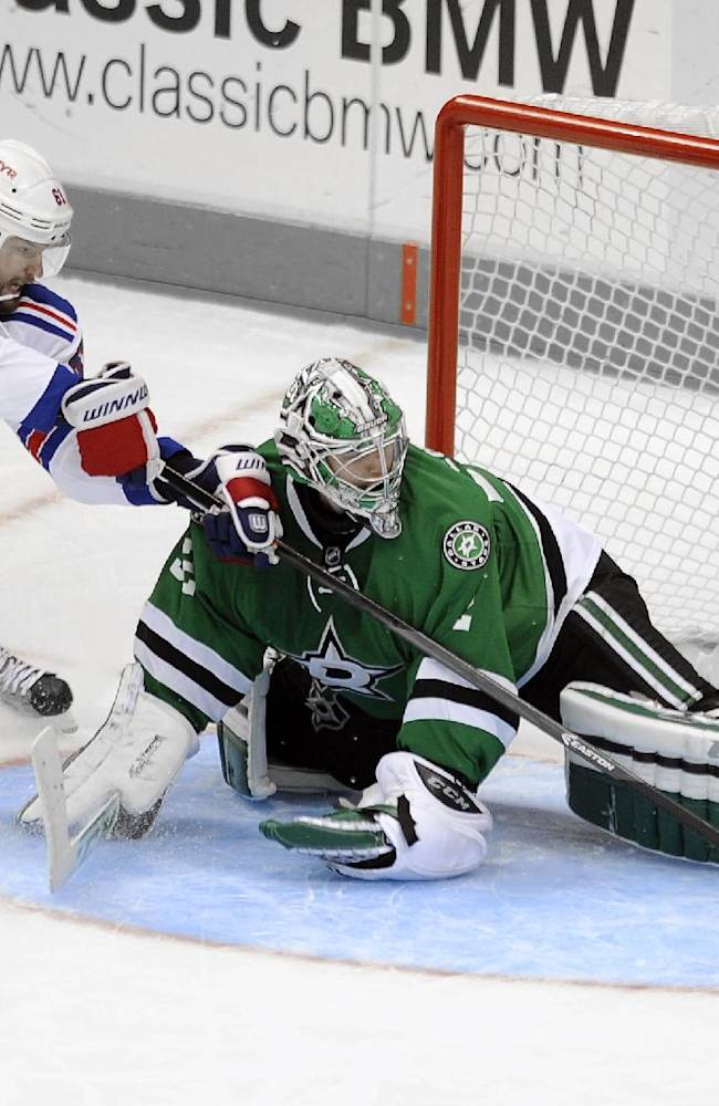 Dallas Stars goalie Kari Lehtonen (32) stops a New York Rangers left wing Rick Nash (61) penalty shot during the third period of an NHL hockey game, Thursday Nov. 21, 2013 in Dallas. New York Rangers won 3-2