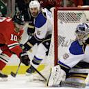 St. Louis Blues goalie Ryan Miller (39) blocks a shot by Chicago Blackhawks' Patrick Sharp (10) during the second period in Game 4 of a first-round NHL hockey playoff series in Chicago, Wednesday, April 23, 2014. (AP Photo/Nam Y. Huh)