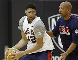 USA Basketball forward/center Anthony Davis (42) of the New Orleans Jazz posts up against a coach during a team practice at the Brooklyn Nets training facility in East Rutherford, N.J., Tuesday, Aug. 19, 2014. (AP Photo/Kathy Willens)