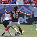 Manchester United's Tom Cleverley, left, blocks an approach to the goal by AS Roma's Salih Ucan (48) during an exhibition soccer match against at Mile High Stadium in Denver, Saturday, July 26, 2014