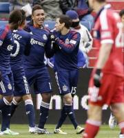 Chivas USA forward Juan Agudelo (11), third from left, celebrates with teammates after scoring his goal during the second half of an MLS soccer match against the Chicago Fire in Bridgeview, Ill., Sunday, March 24, 2013. Chivas USA won 4-1. (AP Photo/Nam Y. Huh)