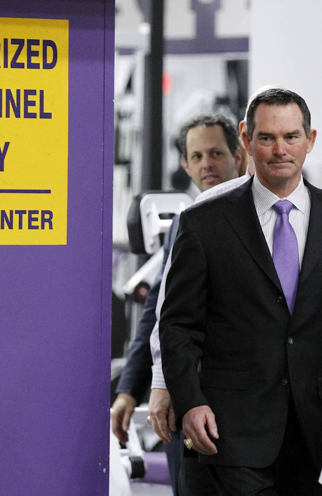 New Minnesota Vikings head coach Mike Zimmer arrives for an NFL football media availability at Winter Park in Eden Prairie, Minn., Friday, Jan. 17, 2014
