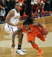 Clemson guard Rod Hall, right, drives the lane as Notre Dame guard V.J. Beachem defends in first half of an NCAA college basketball game, Tuesday, Feb. 11, 2014, in South Bend, Ind. (AP Photo/Joe Raymond)