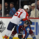 Florida Panthers defenseman Brian Campbell (51) pushes down Colorado Avalanche center Maxime Talbot (25) during the first period of an NHL hockey game on Saturday, Nov. 16, 2013, in Denver The Associated Press