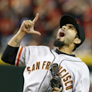 San Francisco Giants' Sergio Romo celebrates the final out against the Arizona Diamondbacks during the ninth inning of an opening day baseball game, Monday, March 31, 2014, in Phoenix. The Giants defeated the Diamondbacks 9-8 The Associated Press