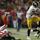 Pittsburgh Steelers wide receiver Antonio Brown (84) moves past Atlanta Falcons wide receiver Eric Weems (14) during the second half of an NFL football game, Sunday, Dec. 14, 2014, in Atlanta The Associated Press